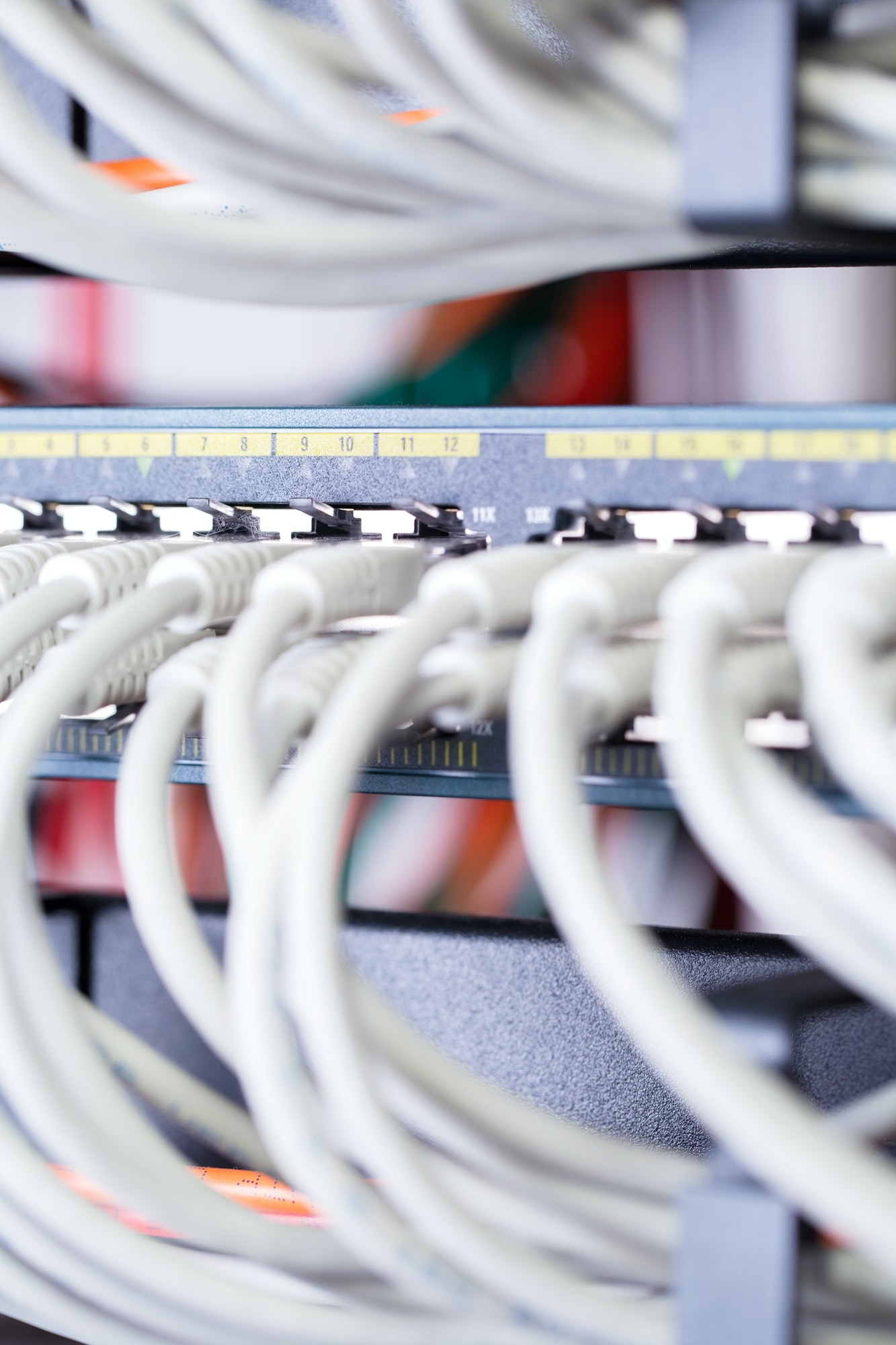 Close-up of gigabit network switch and cables in datacenter